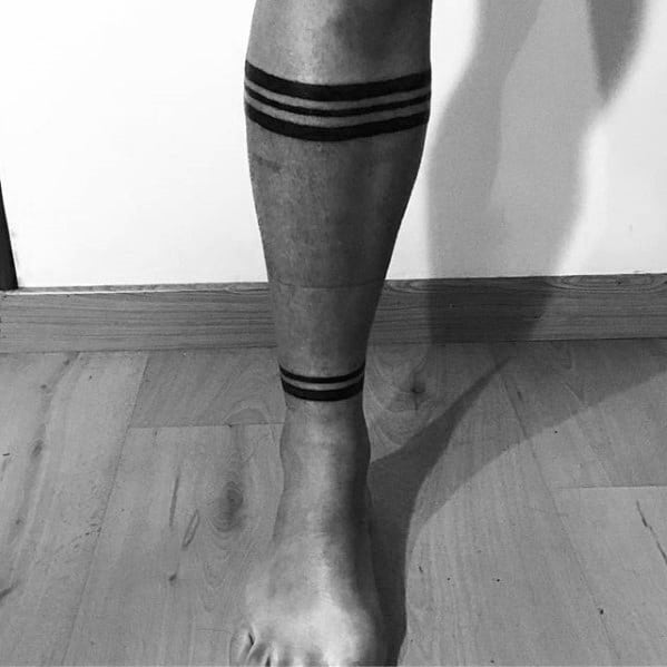 Gentleman With Simple Leg Band Tattoos