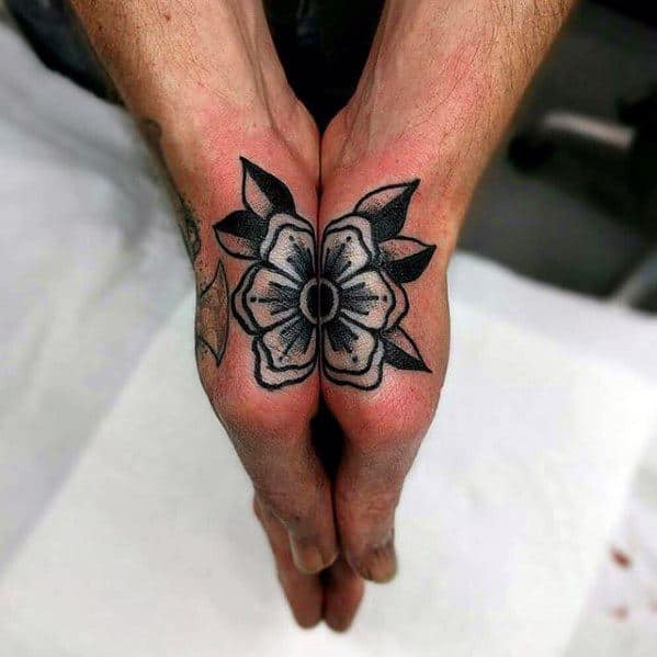 Gentleman With Simple Traditional Flower Hand Tattoo