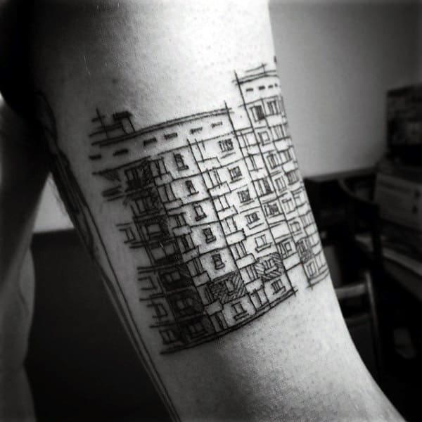 Gentleman With Sketched Building Outline Tattoo On Arm