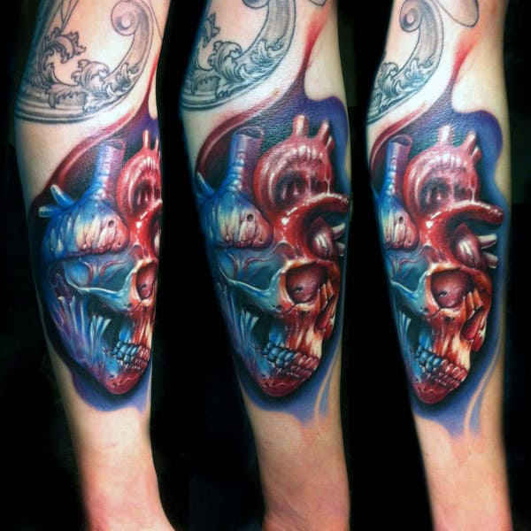 Gentleman With Skull And Heart Tattoo In Abstract Style On Forearm