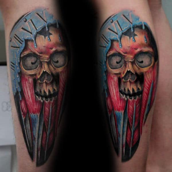 Gentleman With Skull And Muscle Leg Tattoo