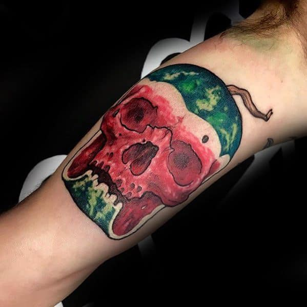 Gentleman With Skull Watermelon Tattoo On Inner Arm Bicep