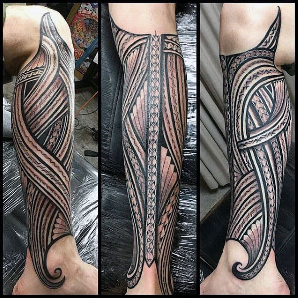 Gentleman With Sleeve Tribal Tattoos Leg