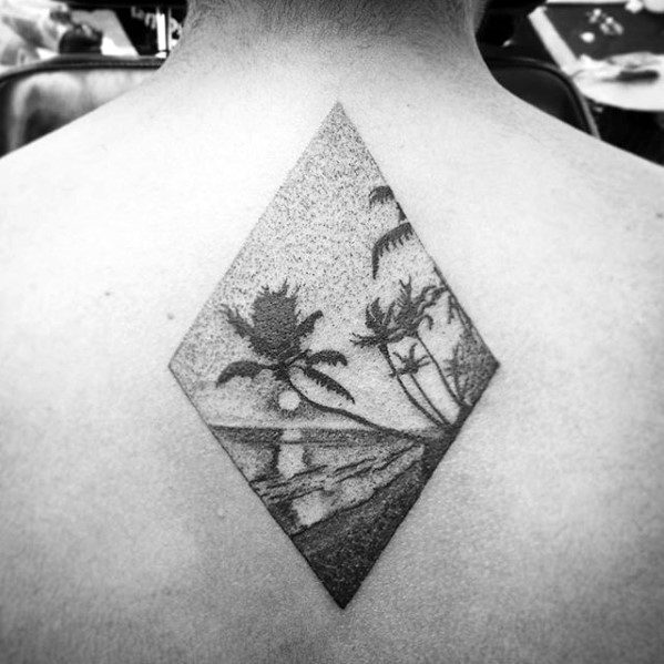 Gentleman With Small Detailed Beach Upper Back Tattoo