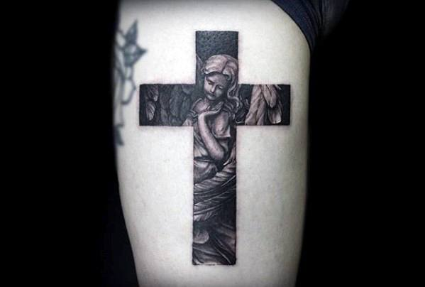Gentleman With Small Religious Angel Cross Tattoo On Thigh