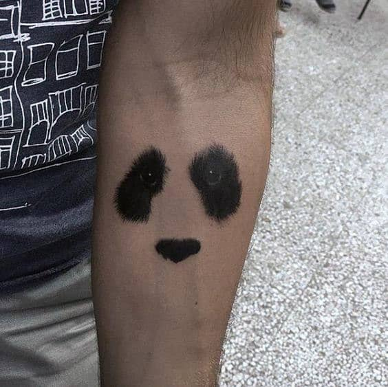 Gentleman With Small Simple Minimalist Panda Eyes And Nose Inner Forearm Tattoo