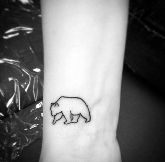 Gentleman With Small Simple Polar Bear Wrist Tattoo