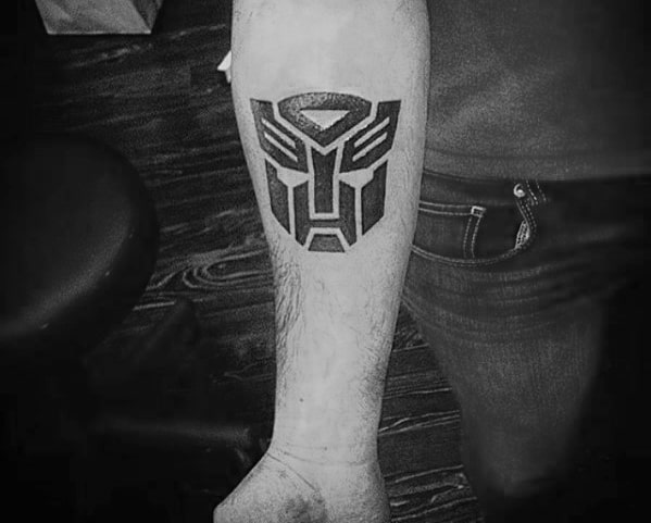 Gentleman With Small Simple Transformers Logo Inner Forearm Tattoo