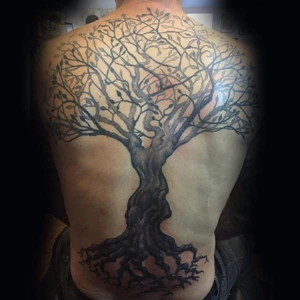 Gentleman With Tattoo Of Full Tree On Back