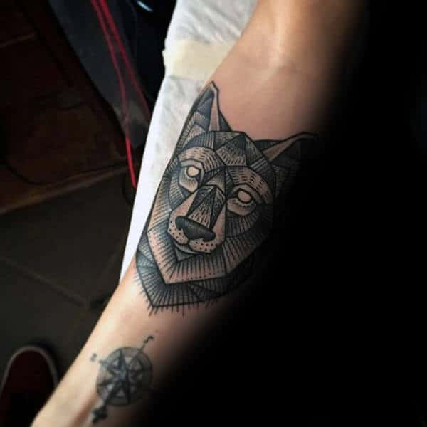 Gentleman With Tattoo Of Geometric Wolf On Forearm