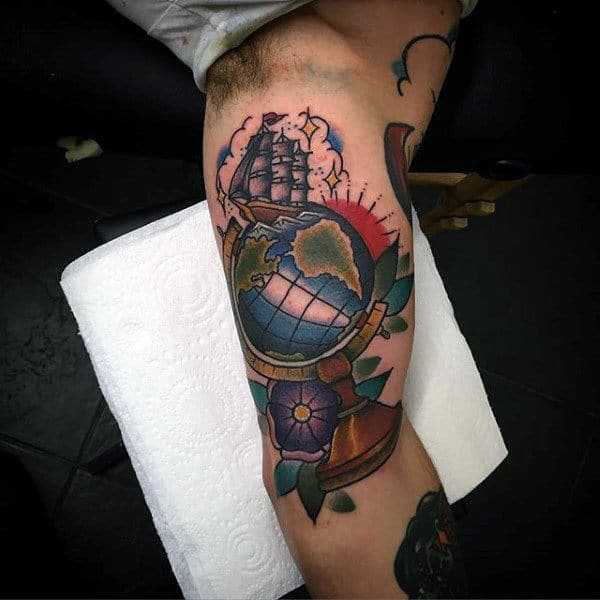 Gentleman With Tattoo Of Sailing Ship And Globe On Arm