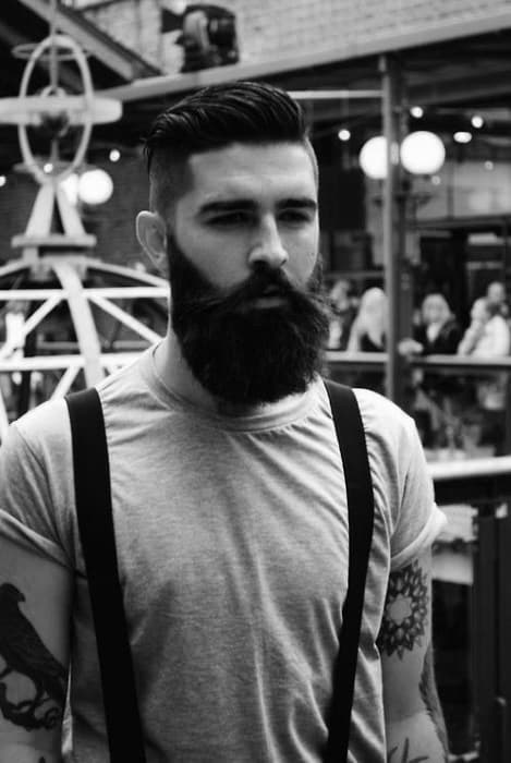 Gentleman With Thick Beard And Medium Length Undercut Hair