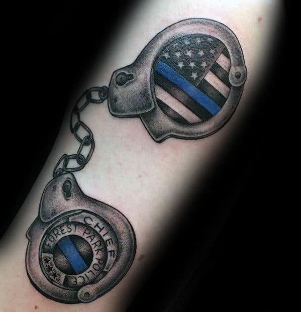 Gentleman With Thin Blue Line Handcuffs Tattoo On Forearm