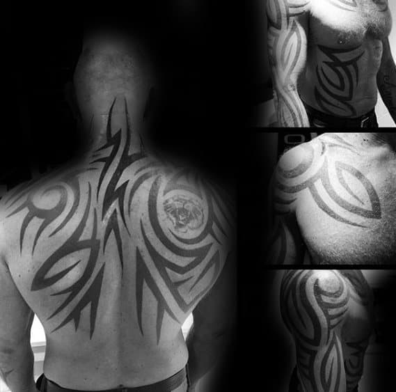 Gentleman With Tribal Back And Neck Tattoo