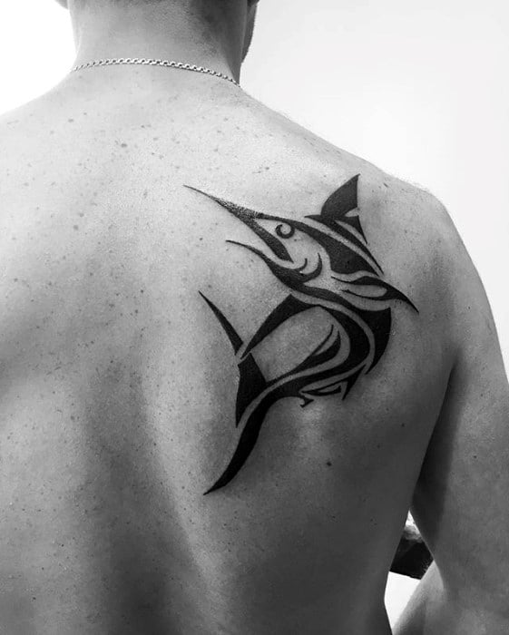 Gentleman With Tribal Black Ink Swordfish Tattoo On Shoulder Blade Of Back