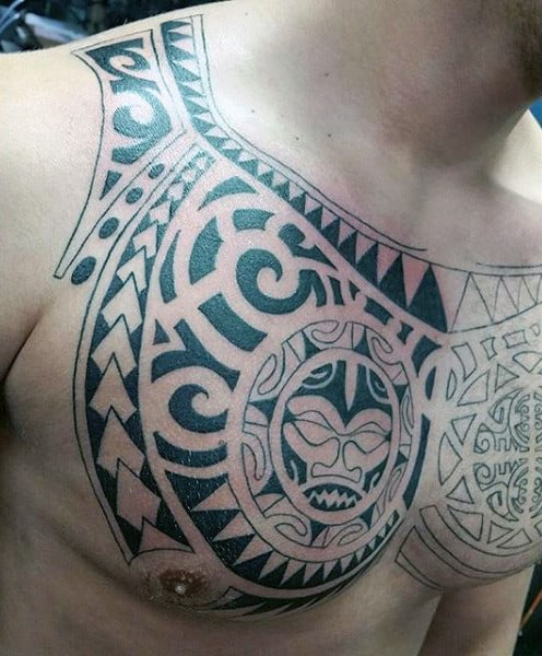 Gentleman With Tribal Chest Tattoo Designs