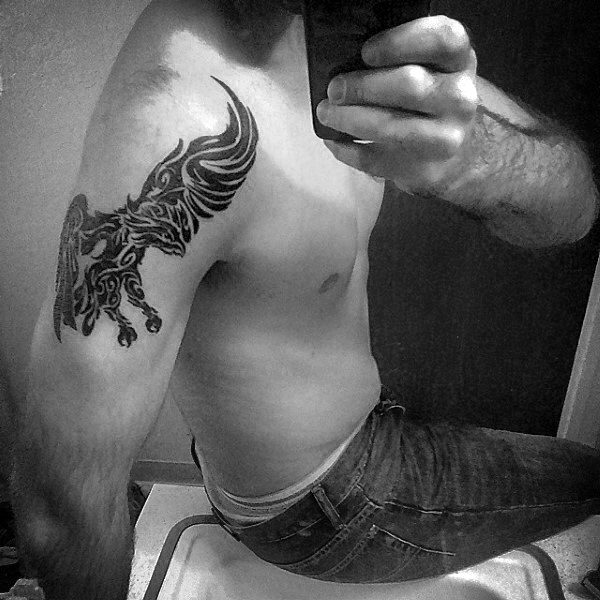 Gentleman With Tribal Eagle Arm Tattoo
