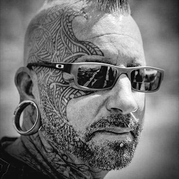 Gentleman With Tribal Face Tattoo Design