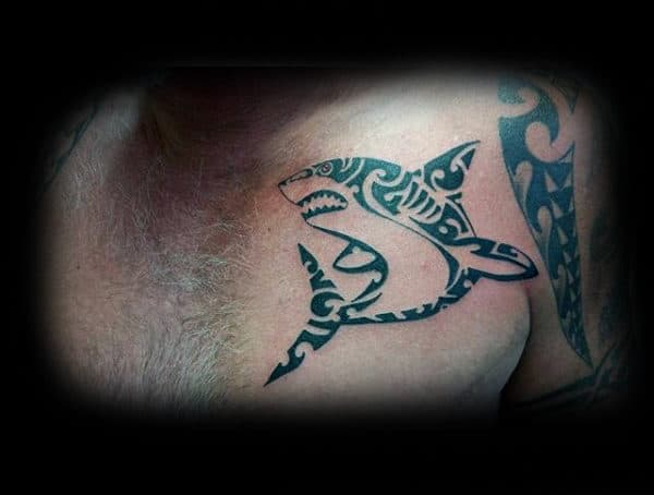 Gentleman With Tribal Shark Tattoo On Upper Chest