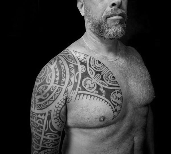 Gentleman With Tribal Shoulder And Half Sleeve Tattoo On Body