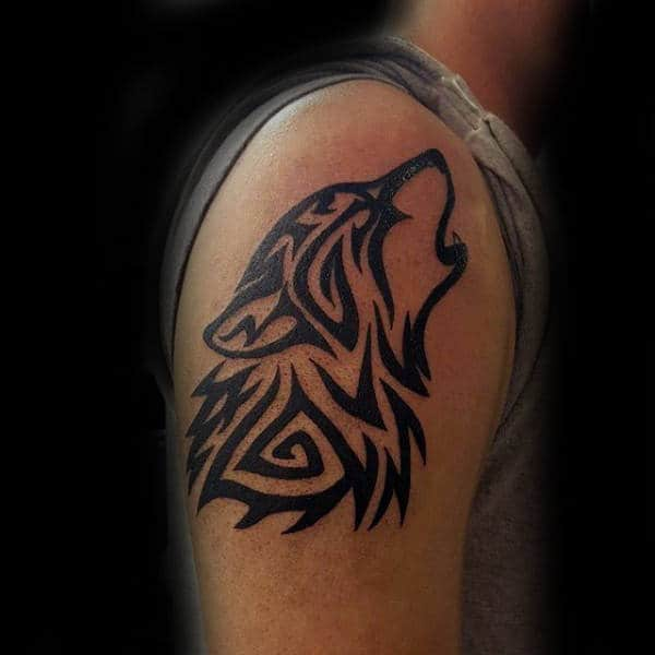Gentleman With Tribal Wolf Upper Arm Howling Tattoo