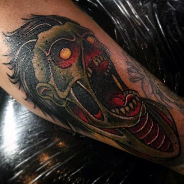 Gentleman With Zombie Face Tattoo On Arm
