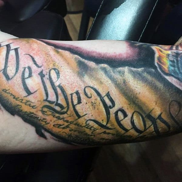 Gentlemen With We The People Tattoo On Arm