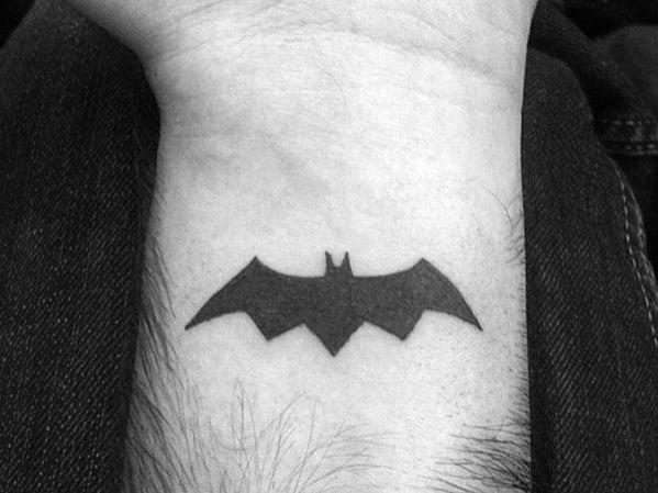 Gentlemens Quarter Sized Batman Symbol Wrist Tattoo Ideas