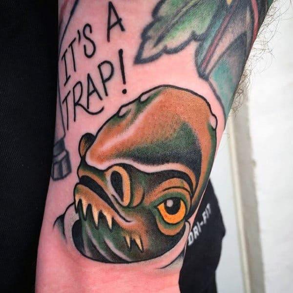 Gentlemens Star Wars Alien Trap Tattoo On Forearms