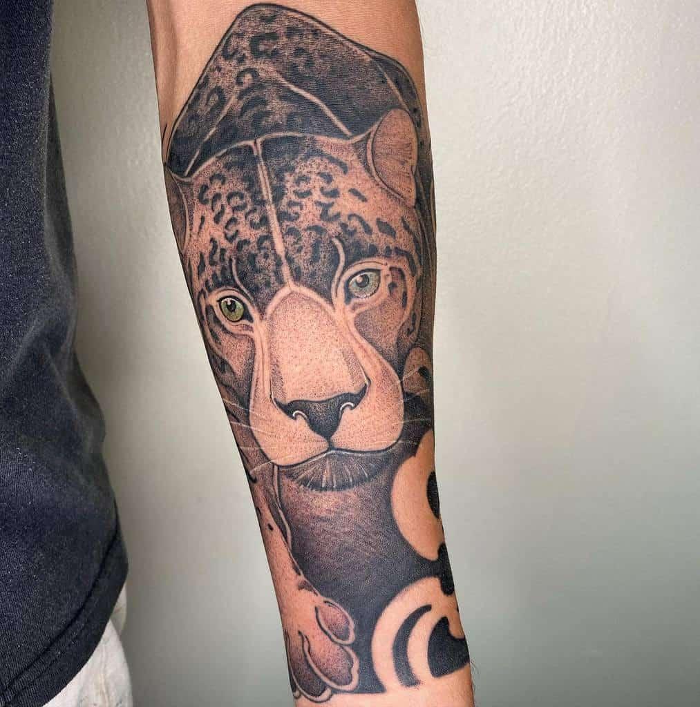 geometric-animal-tribal-jaguar-tattoo-paulomiabara