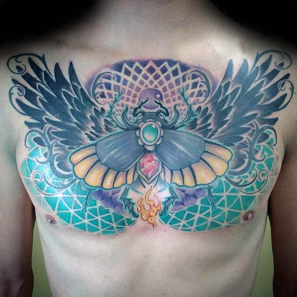geometric mens scarab upper chest tattoo