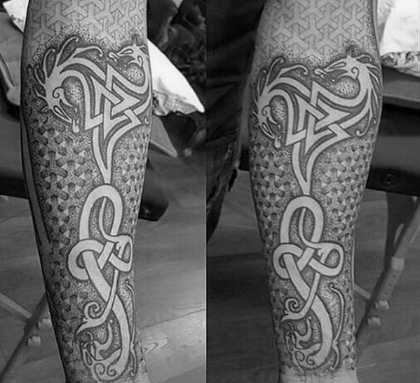 Geometric Negative Space Celtic Dragon Forearm Sleeve Tattoos For Men