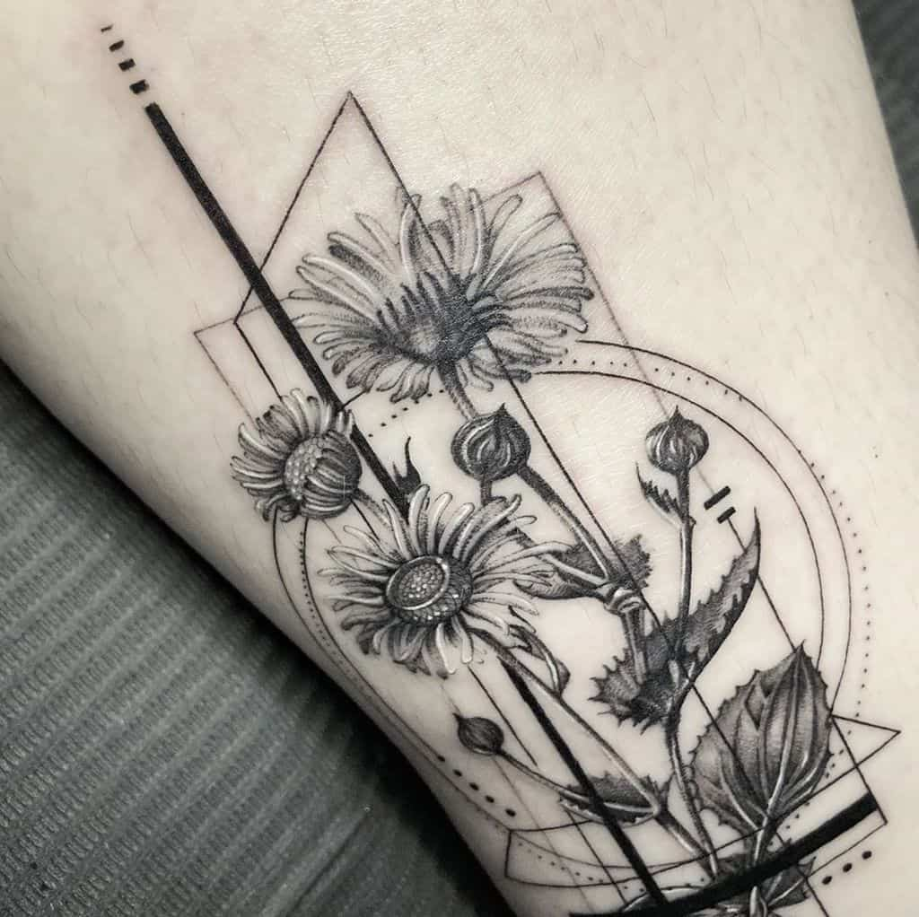 Black and grey and white geometric ornamental daisy tattoo