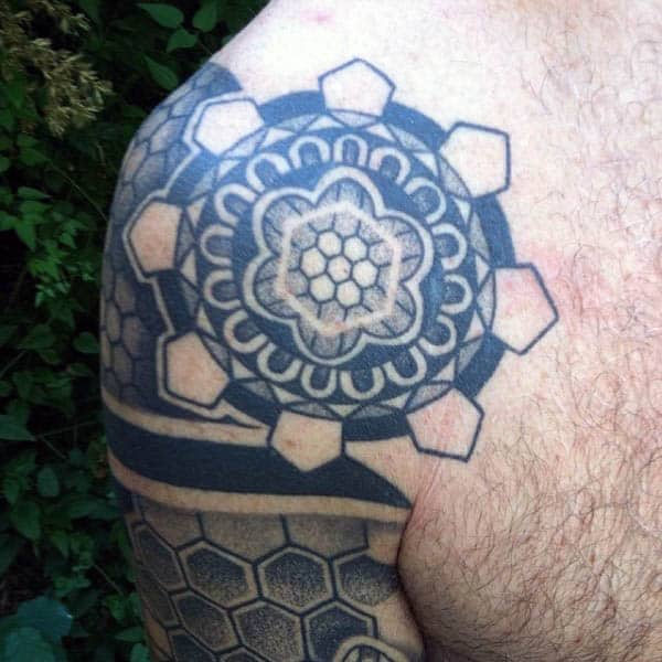 Geometric Pattern Upper Arm Tattoo With Negative Space For Males