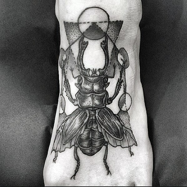 geometric scarab bettle foot tattoos for men