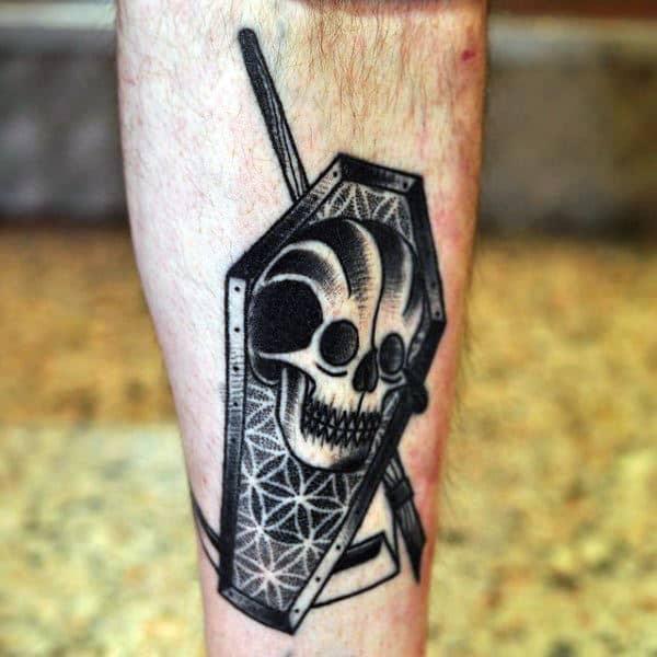 Geometric Skull Coffin Tattoo On Male