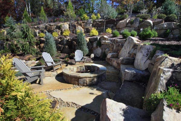Giant Rocks Sloped Fire Pit Landscaping Design Ideas