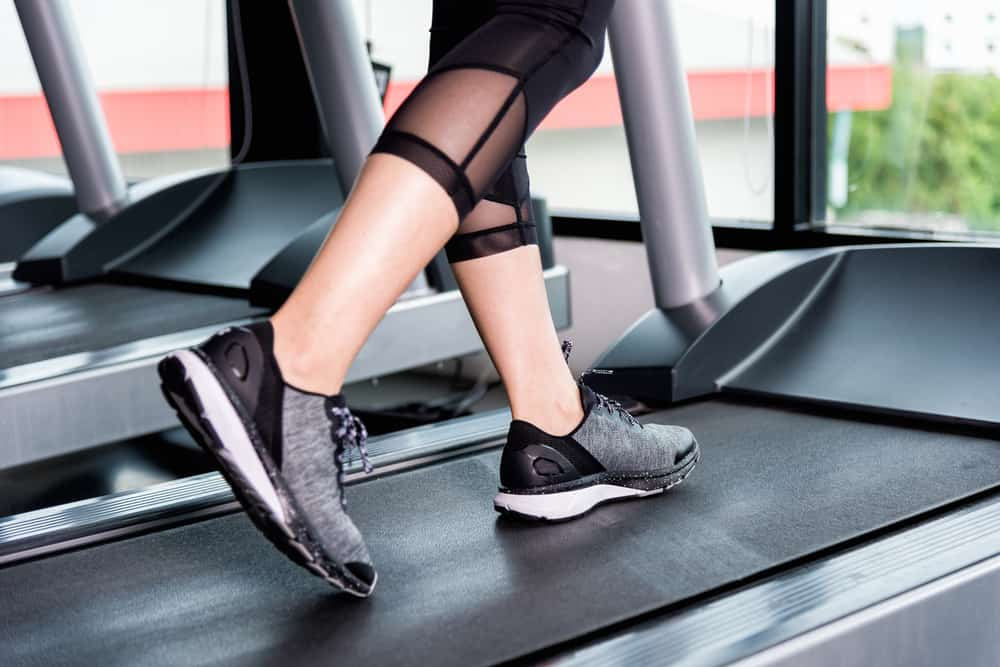 girl cardio running with black shoes