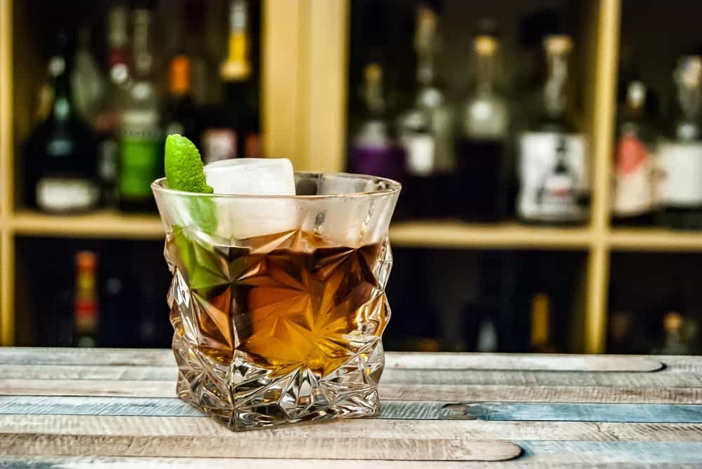glass filled with whisky and ice