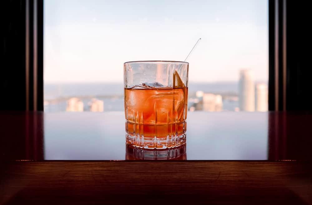 focus glass of liquor on table