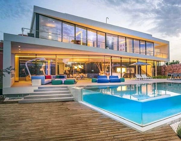 Glass Swimming Pool Outdoors With Wood Deck
