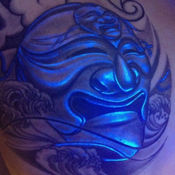 Glow In The Dark Tattoo Of Religous Face On Mans Chest