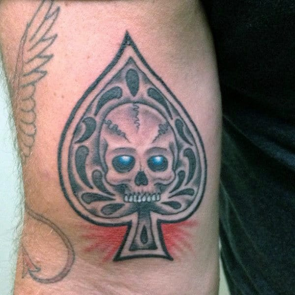 Glowing Blue Eyed Skull Inside Ace Symbol Tattoo Male Forearms
