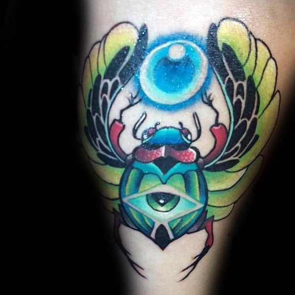 glowing eye scarab male thigh tattoo design ideas