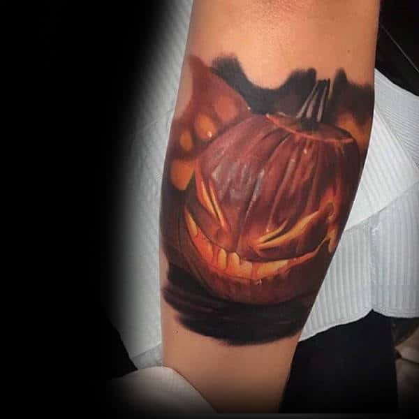 Glowing Halloween Pumpkin Tattoo Male Forearms