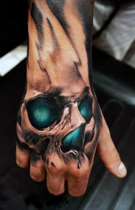 Glowing Teal Skull Tattoo On Hand With 3d Design For Men