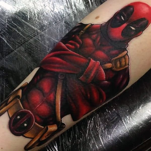 Gold And Red Deadpool Male Forearm Tattoos