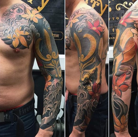 Golden Masked Figure Japanese Sleeve Tattoo For Guys