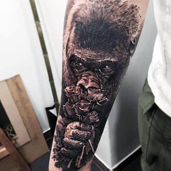 Gorilla Ape Tattoo Smelling Flowers Tattoo On Back Of Forearm For Men