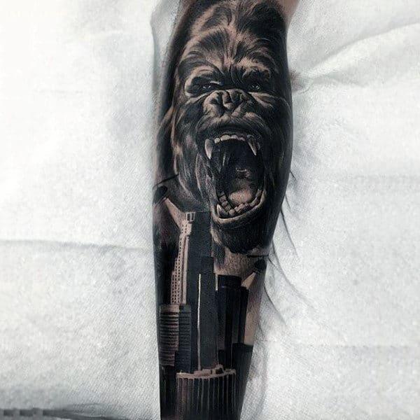 Gorilla City Skyline Forearm Sleeve Tattoo On Man